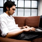 Picture of man using laptop for Facebook